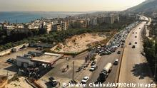 An aerial view show vehicles on the left lane adjacent to a petrol station queueing-up for fuel as traffic flows through on the Tripoli-Beirut highway at the coastal city of Qalamun in northern Lebanon on July 1, 2021 amidst severe fuel shortages. (Photo by Ibrahim CHALHOUB / AFP) (Photo by IBRAHIM CHALHOUB/AFP via Getty Images)