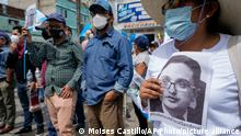 People attend a rally in support of anti-corruption prosecutor Juan Francisco Sandoval, in Guatemala City, Saturday, July 24, 2021. Sandoval fled Guatemala late Friday, arriving in neighboring El Salvador just hours after he was removed from his post. (AP Photo/Moises Castillo)