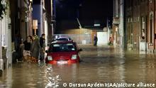 NAMUR, BELGIUM - JULY 24: People wade through flooded streets of Belgium's Namur following heavy rains on July 24, 2021. Dursun Aydemir / Anadolu Agency