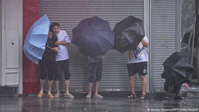 Residents in Nongbo take shelter from heavy rain