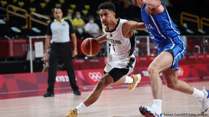 Germany's Maodo Lo dribbles the ball in the men's preliminary round group B basketball match between Germany and Italy during the Tokyo 2020 Olympic Games