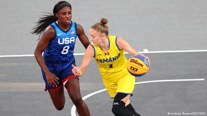Claudia Cuic of Romania in action with Jackie Young of the United States during a match at Tokyo 2020