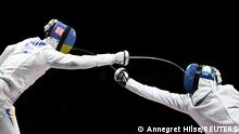 Tokyo 2020 Olympics - Fencing - Men's Individual Epee - Bronze medal match - Makuhari Messe Hall B - Chiba, Japan - July 25, 2021. Andrea Santarelli of Italy in action against Igor Reizlin of Ukraine REUTERS/Annegret Hilse