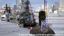 VLADIVOSTOK, RUSSIA - JULY 25, 2021: Vessels take part in a naval parade in the Golden Horn Bay marking Russian Navy Day. Dmitry Yefremov/TASS