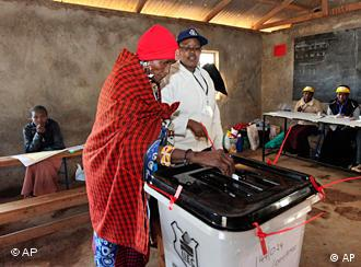A Masai woman casts her vote at a polling station in Kenya.