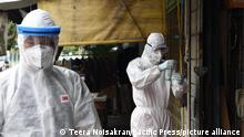 Monk from Wat Sutthi Wararam with dressed in PPE using rapid antigen test for initial screening of COVID-19 for people In the community near Wat Sutthi Wararam with the Coronavirus pandemic in Bangkok, July 25, 2021. (Photo by Teera Noisakran / Pacific Press)