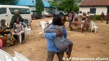 Parents are reunited with released students of the Bethel Baptist High School in Damishi, Nigeria, on Sunday, July 25, 2021. Armed kidnappers in Nigeria have released 28 of the more than 120 students who were abducted at the beginning of July from the Bethel Baptist High School in the northern town of Damishi. Church officials handed those children over to their parents at the school on Sunday. (AP Photo)