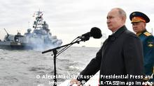 ST PETERSBURG, RUSSIA JULY 25, 2021: Russia s Defence Minister Sergei Shoigu and Russia s President Vladimir Putin R-L review warships before the main naval parade marking Russian Navy Day in the Gulf of Finland. Alexei Nikolsky/Russian Presidential Press and Information Office/TASS PUBLICATIONxINxGERxAUTxONLY TS109536