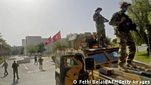 26.7.2021***Tunisian military forces guard the area around the parliament building in the capital Tunis on July 26, 2021, following protests in reaction to a move by the president last night to suspend the north African country's parliament and dismiss the Prime Minister. - Tunisia was plunged deeper into crisis as President Kais Saied suspended parliament and dismissed Prime Minister Hichem Mechichi late July 25, prompting the country's biggest political party to decry a coup d'etat. (Photo by FETHI BELAID / AFP) (Photo by FETHI BELAID/AFP via Getty Images)