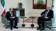 26.07.21 *** In this photo released by Lebanese government, Lebanese President Michel Aoun, left, meets with former Lebanese Prime Minister Najib Mikati, at the presidential palace, in Baabda, east of Beirut, Lebanon, Monday, July 26, 2021. Mikati, a former Lebanese premier and billionaire businessman was slated to be appointed prime minister Monday, 10 days after Saad Hariri stepped down from the job, citing key differences with President Michel Aoun amid an unprecedented financial meltdown. (Dalati Nohra/Lebanese Official Government via AP)