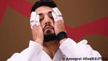 Judoca israelense Tohar Bulut leva as mãos ao rosto