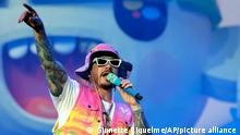 FILE - Singer J Balvin performs during the Coca-Cola Flow Reggaeton festival in Mexico City on Nov. 23, 2019. J Balvin, Dua Lipa and Bad Bunny launched the single Un Dia (One Day) produced by Tainy on July 23, 2020. (AP Photo/Ginnette Riquelme, File)