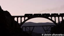 epa03875143 A train passes on the Veresk bridge in Savadkuh county in Mazandaran province, northern Iran, 19 September 2013. The bridge was constructed mostly by Germans during World War II by leadership of an Austrian engineer named Walter Inger, constructed during the reign of Reza Shah. During World War II, it was known as the bridge of victory. The bridge stands at 110 meter tall and its arch measures 66 m. The bridge transfer Iranian Railway networks in Northern Iran. EPA/ABEDIN TAHERKENAREH ++