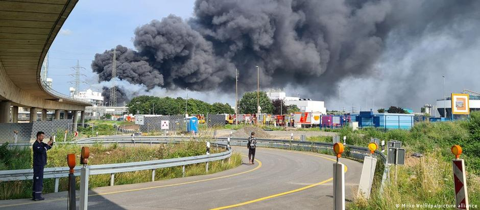 Plumes of black smoke extend across the sky following the explosion in Leverkusen