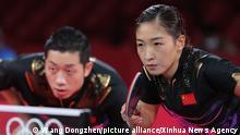 (210726) -- TOKYO, July 26, 2021 (Xinhua) -- Xu Xin/Liu Shiwen (R) of China react during the table tennis mixed doubles gold medal match against Mizutani Jun/Ito Mima of Japan at the Tokyo 2020 Olympic Games in Tokyo, Japan, July 26, 2021. (Xinhua/Wang Dongzhen)