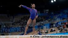 Simone Biles, of the United States, performs on the balance beam during the women's artistic gymnastic qualifications at the 2020 Summer Olympics, Sunday, July 25, 2021, in Tokyo. (AP Photo/Ashley Landis)