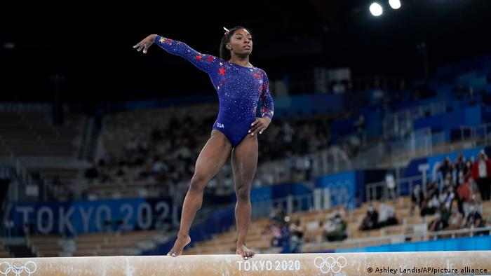 Simone Biles, of the United States, performs on the balance beam during the women's artistic gymnastic qualifications at the 2020 Summer Olympic Games