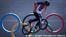 Justin Dowell, of the United States, makes a jump during a BMX Freestyle training session at the 2020 Summer Olympics, Tuesday, July 27, 2021, in Tokyo, Japan. (AP Photo/Ben Curtis)