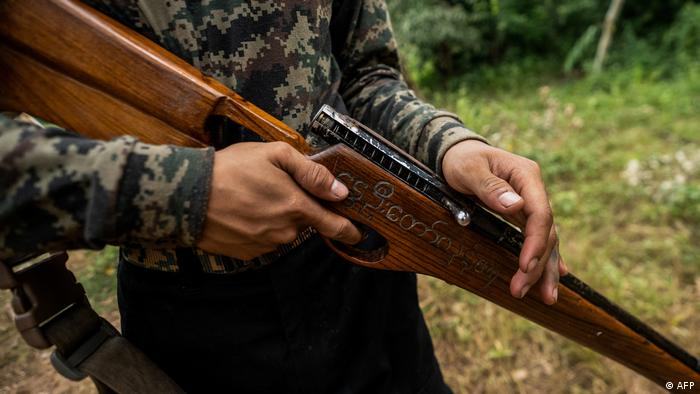 A Myanmar resistance force fighter holds a homemade weapon