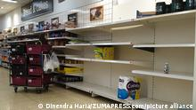 July 23, 2021, London, UK, UK: London, UK. A Sainsbury's staff member next to empty shelves in a Sainsbury's store in London. The government has announced that daily contact testing will be rolled out to workplaces in the food sector, so staff who have been pinged by the COVID-19 app can keep working if they test negative rather than isolating. This is because a number of supermarkets are reporting empty shelves as they, wholesalers and hauliers are struggling to ensure enough food and fuel supplies, after the COVID-19 NHS app alerted workers to isolate after being in contact with someone with COVID-19. (Credit Image: © Dinendra Haria/London News Pictures via ZUMA Press Wire