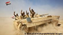 Iraqi forces backed by the Hashed Al-Shaabi (Popular Mobilization units) advance towards the town of Tal Afar, west of Mosul, after the Iraqi government announced the beginning of the operation to retake it from the control of the Islamic State (IS) group on August 22, 2017. Iraqi forces recaptured from the Islamic State group the first two districts of jihadist bastion Tal Afar, as the Pentagon chief visited Baghdad in a show of support. / AFP PHOTO / AHMAD AL-RUBAYE (Photo credit should read AHMAD AL-RUBAYE/AFP via Getty Images)