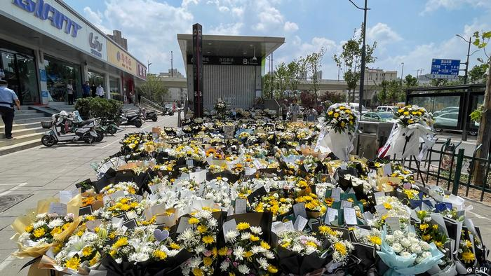 Flowers placed as tributes in front of a subway station in memory of flood victims