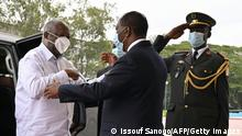 Ivory Coast President Alassane Ouattara (C) welcomes former President Laurent Gbagbo (L) at the presidential palace in Abidjan, on July 27, 2021. - Ivory Coast President Alassane Ouattara offered a hearty welcome to his predecessor Laurent Gbagbo on July 27, 2021 as the rivals met for the first time since the West African country's deadly 2010-11 conflict. (Photo by Issouf SANOGO / AFP) (Photo by ISSOUF SANOGO/AFP via Getty Images)