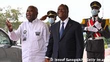 Ivory Coast President Alassane Ouattara (C) poses with former President Laurent Gbagbo (L).