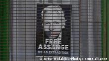 Free Assange poster seen in a window of a closed shop in Dublin city center during Level 5 Covid-19 lockdown. On Tuesday, 16 March 2021, in Dublin, Ireland. (Photo by Artur Widak/NurPhoto)