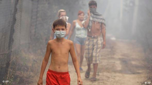 Children wearing masks in a forest in Russia