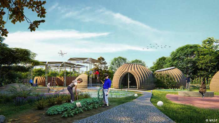 A housing settlement comprising of domes made of clay with two people tending to the garden