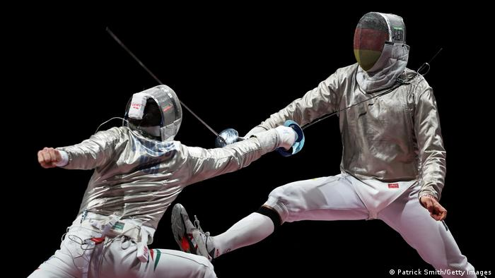 Csanad Gemesi of Team Hungary (left) competes against Max Hartung of Team Germany