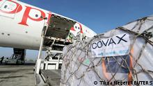 FILE PHOTO: Ethiopian Airlines staff unload AstraZeneca/Oxford vaccines under the COVAX scheme against the coronavirus disease (COVID-19) from a cargo plane at Bole International Airport in Addis Ababa, Ethiopia, March 7, 2021. REUTERS/Tiksa Negeri/File Photo