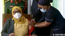 Tanzania's President Samia Suluhu Hassan receives her Johnson & Johnson vaccine against the coronavirus disease (COVID-19) at State House in Dar es Salaam, Tanzania July 28, 2021. REUTERS/Emmanuel Herman NO RESALES. NO ARCHIVES