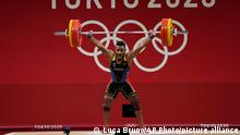 Julio Ruben Mayora Pernia of Venezuela competes in the men's 73kg weightlifting event, at the 2020 Summer Olympics, Wednesday, July 28, 2021, in Tokyo, Japan. (AP Photo/Luca Bruno)