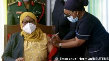 28.07.21 *** Tanzania's President Samia Suluhu Hassan receives her Johnson & Johnson vaccine against the coronavirus disease (COVID-19) at State House in Dar es Salaam, Tanzania July 28, 2021. REUTERS/Emmanuel Herman NO RESALES. NO ARCHIVES