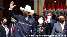 Peru's President-elect Pedro Castillo waves as he and his wife Lilia Paredes leave the Foreign Ministry to go to Congress for his swearing-in ceremony on his Inauguration Day in Lima, Peru, Wednesday, July 28, 2021. (AP Photo/Guadalupe Pardo)