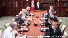 TUNIS, TUNUSIA - JULY 28: (----EDITORIAL USE ONLY MANDATORY CREDIT - TUNISIAN PRESIDENCY / HANDOUT - NO MARKETING NO ADVERTISING CAMPAIGNS - DISTRIBUTED AS A SERVICE TO CLIENTS----) Tunisian President Kais Saied (Rear C) holds a meeting with security officials and military command echelon at the Carthage Palace in Tunis, Tunisia on July 28, 2021. Tunisian Presidency / Handout / Anadolu Agency