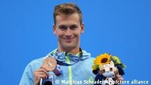 Mykhailo Romanchuk of Ukraine poses with his bronze medal following the men's 800-meters freestyle final at the 2020 Summer Olympics, Thursday, July 29, 2021, in Tokyo, Japan. (AP Photo/Matthias Schrader)