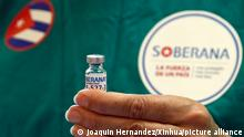 (210401) -- HAVANA, April 1, 2021 (Xinhua) -- A medical worker presents a dose of locally made COVID-19 vaccine Soberana 02 in Havana, Cuba on March 31, 2021. The Soberana 02 vaccine has entered phase 3 clinical trials earlier in March in Havana. (Photo by Joaquin Hernandez/Xinhua)