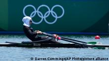 Nazanin Malaei of Iran competes in the women's single sculls quarterfinal at the 2020 Summer Olympics, Sunday, July 25, 2021, in Tokyo, Japan. (AP Photo/Darron Cummings)