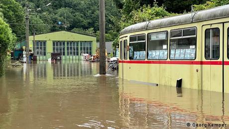 Vintage street cars standing in flood water