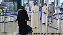 31.05.2020 Saudi passengers queue for a temperature check at terminal 5 in the King Fahad International Airport, designated for domestic flights, in the capital Riyadh on May 31, 2020, after authorities lifted the ban on flights within the country. (Photo by FAYEZ NURELDINE / AFP) (Photo by FAYEZ NURELDINE/AFP via Getty Images)