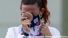 Bronze medalist Alessandra Perilli, of San Marino, celebrates after the women's trap at the Asaka Shooting Range in the 2020 Summer Olympics, Thursday, July 29, 2021, in Tokyo, Japan. (AP Photo/Alex Brandon)