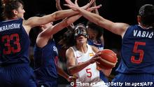 TOPSHOT - Spain's Cristina Ouvina (C) runs with the ball past Serbia's Tina Krajisnik (L) and Sonja Vasic (R) in the women's preliminary round group A basketball match between Spain and Serbia during the Tokyo 2020 Olympic Games at the Saitama Super Arena in Saitama on July 29, 2021. (Photo by Thomas COEX / AFP) (Photo by THOMAS COEX/AFP via Getty Images)