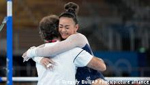 Sunisa Lee, of the United States, embraces her coach Jeff Graba after performing on the uneven bars during the artistic gymnastics women's all-around final at the 2020 Summer Olympics, Thursday, July 29, 2021, in Tokyo. (AP Photo/Gregory Bull)