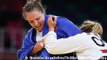 TOKYO, JAPAN - JULY 29, 2021: ROC athlete Aleksandra Babintseva (L) and DR Congo's Marie Branser fight in their women's 78kg elimination round of 32 judo bout at the 2020 Summer Olympic Games, at Nippon Budokan Indoor Arena. Stanislav Krasilnikov/TASS