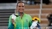 Brazil's Rebeca Andrade displays her silver medal for the artistic gymnastics women's all-around at the 2020 Summer Olympics, Thursday, July 29, 2021, in Tokyo. (AP Photo/Gregory Bull)