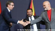 29.07.2021 Serbia's President Aleksandar Vucic, left, and Albania's Prime Minister Edi Rama, right, shake hands next to North Macedonia's Prime Minister Zoran Zaev, center, after signing memorandums and agreements of regional cooperation during the economic forum for regional cooperation in Skopje, North Macedonia, Thursday, July 29, 2021. Frustrated with infinite delays in a process to join the European Union, three Balkan leaders have agreed on Thursday their countries to open borders in 2023 to secure free movement of people and goods without administrative procedures. (AP Photo/Boris Grdanoski)
