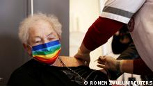 FILE PHOTO: An elderly woman receives a booster shot of her vaccination against the coronavirus disease (COVID-19) at an assisted living facility, in Netanya, Israel January 19, 2021. REUTERS/Ronen Zvulun/File Photo